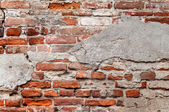 Old brick wall with chipped plaster — Stock Photo
