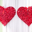 Braided red heart as a wedding decoration — Stock Photo