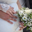 Hands of the groom and the bride with wedding rings — Stock Photo #26835435