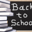 Books with back to school chalkboard text background — Stock Photo #34223837