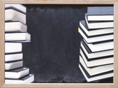 Hardcover books with chalkboard background — Stock Photo