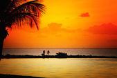 Pláž při západu slunce — Stock fotografie