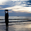 Stock Photo: Silhouette girl on beach