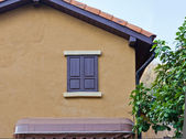 Wooden window on a house wall — Stock Photo