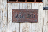 Guest Only Sign on wooden door — Stock Photo