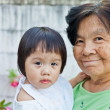 Stock Photo: Little baby with grandmother
