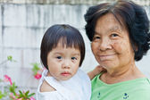 Little baby with grandmother — Stock Photo
