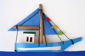 Wooden Boat on a Picture Board — Stock Photo