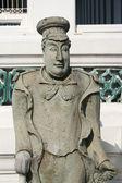 Statua di pietra antico signore nel tempio di buddha, thailandia — Foto Stock