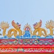 Dragon statue on china temple roof — Stock Photo #23814205