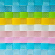 Colorful wicker plastic background — Stock Photo