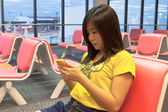 Asian girl waiting in the airport — Stock Photo