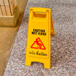 Wet floor caution sign on floor — Stock Photo