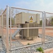Stock Photo: High-voltage substation in metal fence