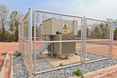 High-voltage substation in a metal fence — Stock Photo