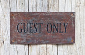 Closeup Guest Only Sign on wooden door — Stock Photo