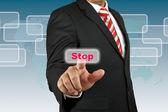 Businessman push Stop button — Stock Photo