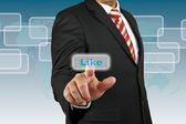 Businessman push Like button — Stock Photo
