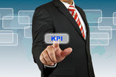 Businessman push KPI button — Stock Photo
