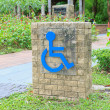 Handicap Sign in a park — Stock Photo