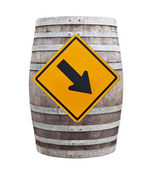 Big old wine barrel with traffic sign isolated on white backgrou — Stock Photo