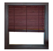 Wooden window frame with bamboo blind — Stock Photo