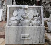 Marble sculpture of money box — Stock Photo