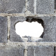 Stock Photo: Hole in concrete wall