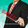 Businessman drawing a graph with Success going down — Stock Photo