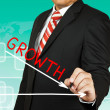 Businessman drawing a graph with Growth going down — Stock Photo