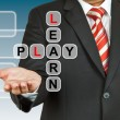 Businessman hand drawing Learn and Play — Stock Photo