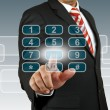 Stock Photo: Businessmhand pushing number pad screen