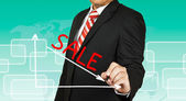 Businessman drawing a graph with Sale going down — Stock Photo