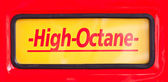 High Octane sign at classic fuel pump on red background — Stock Photo