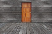Wall with door and floor siding weathered wood background — Stock Photo
