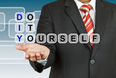 Businessman with wording Do It Yourself — Stock Photo