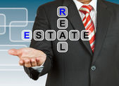 Businessman hand drawing Real Estate — Stock Photo