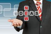 Businessman hand drawing New Ideas — Stock Photo