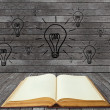Stock Photo: Book and lightbulb in wood room