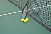 Tennis Court with racket and balls on net — Stok fotoğraf