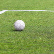 Old ball on soccer field — Stock Photo #28893605