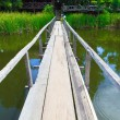 Wooden bridge over the canal — Stock Photo