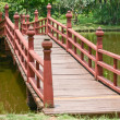 Stock Photo: Wooden bridge over lake