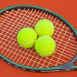 Tennis court with ball and racket — Stock Photo