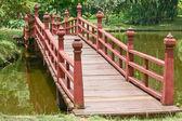 Wooden bridge over a lake — Stock Photo