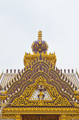 Detail of ornately decorated unconstruction temple roof — Stock Photo