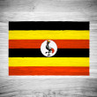 Uganda flag on wood texture — Stock Photo