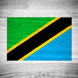 Tanzania flag on wood texture — Stock Photo