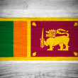 Sri Lanka flag on wood texture — Stock Photo