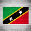 Saint Kitts and Nevis flag on wood texture — Foto Stock